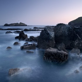 A long exposure captures the movement of the ocean at Godrevy Lighthouse, Cornwall.