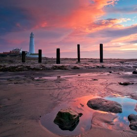 Sunrise at St Mary's Lighthouse, Whitley Bay, Tyneside, England.