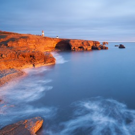 Sunrise at Byer's Hole with Souter Lighthouse in the distance, taken at sunrise.