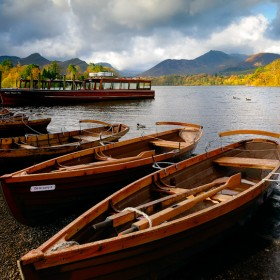 Boats on the shore at Derwent Water, Keswick, Cumbria, England.