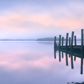 A misty morning at Barrow Landing stage, Derwent Water during winter.