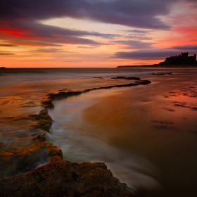 Sunrise at Bamburgh Castle, Northumberland, England.