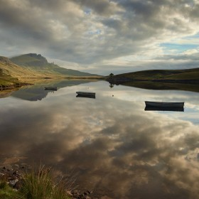 Fishing boats on Loch Fada and The Storr, Isle of Skye, Scotland.