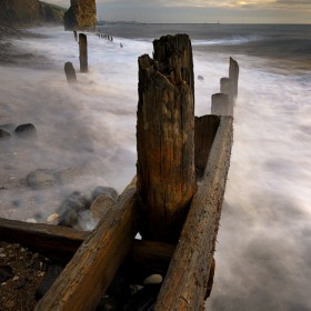Liddle Stack & Old Jetty provide the focal points while crashing waves pound the beach during stormy seas.